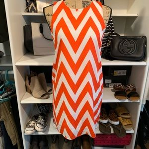 Orange and white chevron dress.